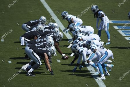 The Las Vegas Raiders lineup on offense against the Carolina Panthers defense during an NFL football game, in Charlotte, N.C