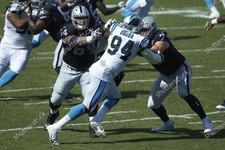 Carolina Panthers defensive end Efe Obada (94) is double teamed by Las Vegas Raiders offensive linemen Kolton Miller (74) and Richie Incognito (64) during the second half an NFL football game, in Charlotte, N.C