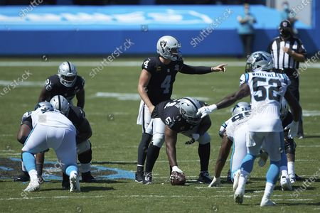 Las Vegas Raiders quarterback Derek Carr (4) directs his offense during the second half of an NFL football game against the Carolina Panthers, in Charlotte, N.C