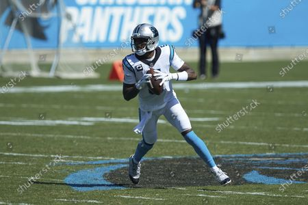 Carolina Panthers quarterback Teddy Bridgewater (5) rolls out of the pocket during the second half an NFL football game against the Las Vegas Raiders, in Charlotte, N.C