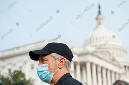 Comedian Jon Stewart, talks with reporters prior to a press conference regarding legislation to assist veterans exposed to burn pits, outside the US Capitol in Washington, DC., Tuesday, September 15, 2020.