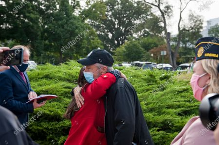 Comedian Jon Stewart, right, embraces Rosie Torres, whose husband Army Capt. (retired) LeRoy Torres died from complications from exposure to burn pits, prior to a press conference regarding legislation to assist veterans exposed to burn pits, outside the US Capitol in Washington, DC., Tuesday, September 15, 2020.