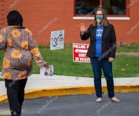 Transgender activist Sarah McBride, who hopes to win a seat in the Delaware Senate, campaigns at Claymont Elementary in Claymont, Del