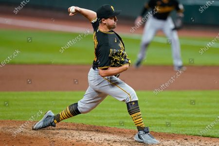 Pittsburgh Pirates relief pitcher Derek Holland throws during the eighth inning of the team's baseball game against the Cincinnati Reds in Cincinnati