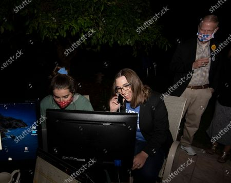 Transgender activist Sarah McBride, who hopes to win a primary election in the Delaware Senate, talks on a cellphone at her watch party in Wilmington, Del