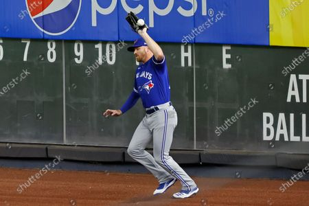 Stock Picture of Toronto Blue Jays right fielder Derek Fisher misses the catch on a ball hit by New York Yankees' Clint Frazier during the second inning of a baseball game, in New York. Fisher was charged with an error