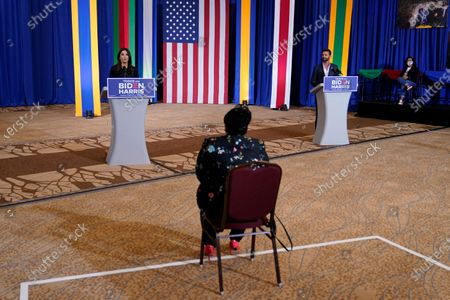 Actress Eva Longoria, left, and performer Ricky Martin speak during a Hispanic Heritage Month event featuring Democratic presidential candidate former Vice President Joe Biden, at Osceola Heritage Park in Kissimmee, Fla