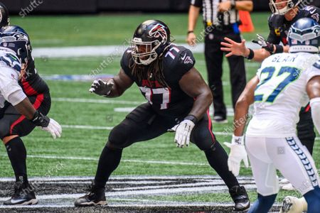 Atlanta Falcons offensive guard James Carpenter (77) works against the Seattle Seahawks during the first half of an NFL football game, in Atlanta. The Seattle Seahawks won 38-25