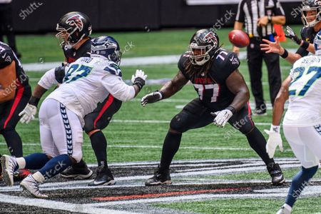 Atlanta Falcons offensive guard James Carpenter (77) prepares to block Seattle Seahawks defensive tackle Poona Ford (97) during the first half of an NFL football game, in Atlanta. The Seattle Seahawks won 38-25
