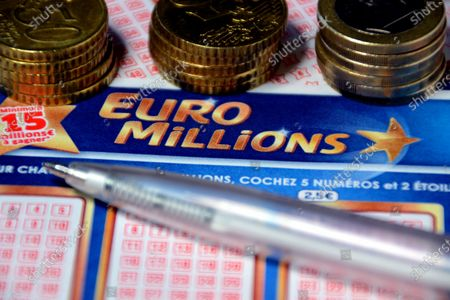In this photo illustration a pen and euros coins on Euromillions tickets. A couple of Alsatians pocketed the 157 million euros of the Euromillions draw of September 1, 2020.