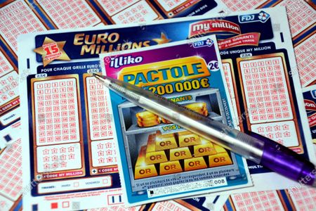 In this photo illustration a pen and a scratch card on Euromillions tickets. A couple of Alsatians pocketed the 157 million euros of the Euromillions draw of September 1, 2020.