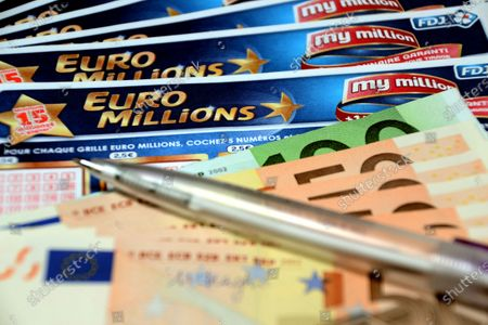 In this photo illustration a pen and euros banknotes on Euromillions tickets. A couple of Alsatians pocketed the 157 million euros of the Euromillions draw of September 1, 2020.
