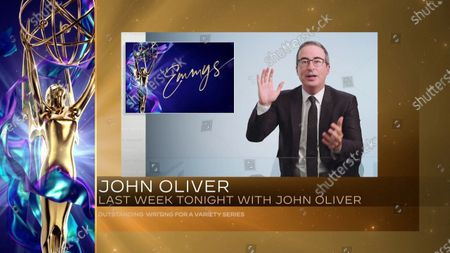 """John Oliver accepts the Emmy for Outstanding Writing For A Variety Series for """"Last Week Tonight With John Oliver"""" during the second night of the 2020 Creative Arts Emmy Awards, streamed live on Emmys.com on"""