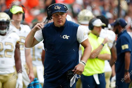 Georgia Tech head coach Geoff Collins is shown during the first half of an NCAA college football game against Miami, in Miami Gardens, Fla. Collins said his field goal unit normally runs eight live repetitions twice a week at practice, but he shortened those drills in a nod to social distancing amid the coronavirus pandemic