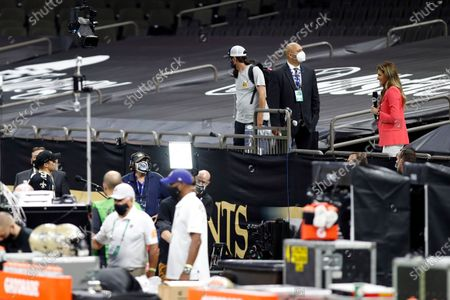 New Orleans Saints quarterback Drew Brees (9) is interviewed by Fox Sports reporter Erin Andrews in the stands during an NFL football game against the Tampa Bay Buccaneers, in New Orleans