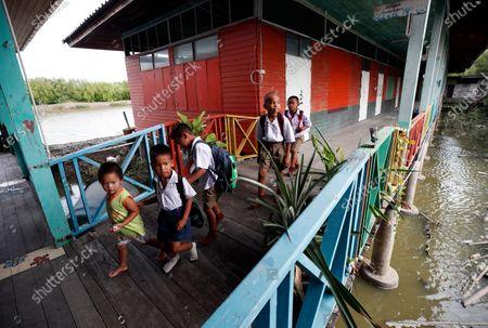 Editorial photo of Coastal erosion and climate change threaten to drown Thailand's Ban Khun Samut Chin village, Phra Samut Chedi - 15 Sep 2020