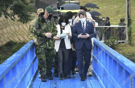 South Korean Unification Minister Lee In-young, right, walks on the blue bridge during a visit to Panmunjom in the Demilitarized Zone, South Korea, . Lee's visit comes days ahead of the second anniversary of a summit agreement signed between South Korean President Moon Jae-in and North Korean leader Kim Jong Un in Pyongyang, North Korea, on Sept. 19, 2018, to reduce tensions and bolster cooperation