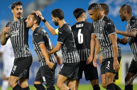 Santi Cazorla (2nd L) of Al Sadd SC celebrates with his teammates after scoring a goal during the AFC Asian Champions League group D football match between Al Sadd SC of Qatar and Al Ain FC of United Arab Emirates at Jassim Bin Hamad Stadium in Doha, Capital of Qatar, Sept. 15, 2020.