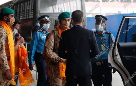 Stock Picture of Sheikh Nasser Bin Hamad Al Khalifa, from the Bahraini royal family, speaks to an airport security officer as he arrives in Tribhuwan International airport in Kathmandu, Nepal, . Sheikh Nasser arrived with an expedition team to attempt to summit Mt Manaslu, an 8,163m high peak which is the eighth tallest mountain in the world