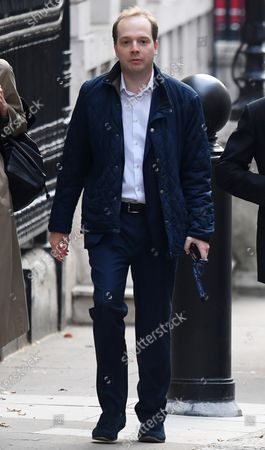 Government special advisor Oliver Lewis arrives at No.10 Downing Street.