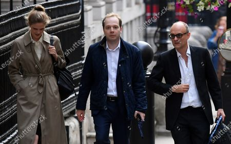 Government special advisors Cleo Watson, Oliver Lewis and Dominic Cummings arrive at No.10 Downing Street.