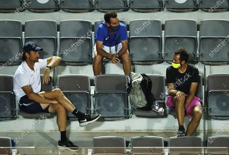 Carlos Moya (L), coach of Rafael Nadal, and Nadal's physio Rafael Maymo (R) follow the second round match between Nadal and Pablo Carreno Busta of Spain at the Italian Open in Rome, Italy, 16 September 2020.