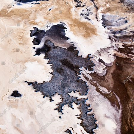 Aerial shots show the incredible array of textures that make up the Death Valley National Park. The abstract images show land patterns and mineral deposits from streams as well as pools created by melted snow and rainwater.
