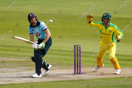 England's Jos Buttler, left, plays a shot during the third ODI cricket match between England and Australia, at Old Trafford in Manchester, England