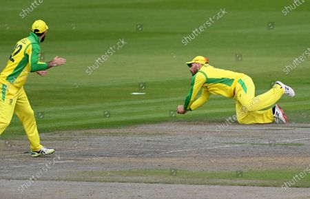 Stock Photo of Australia's captain Aaron Finch, right, takes the catch to dismiss England's Jos Buttler during the third ODI cricket match between England and Australia, at Old Trafford in Manchester, England