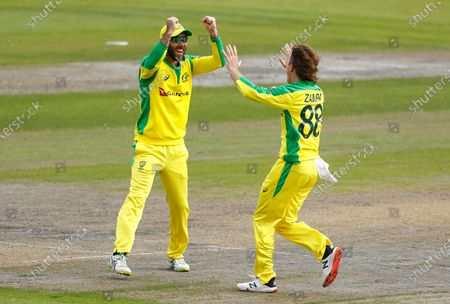 Stock Picture of Australia's Adam Zampa, right, celebrates with teammate Glenn Maxwell the dismissal of England's Jos Buttler during the third ODI cricket match between England and Australia, at Old Trafford in Manchester, England