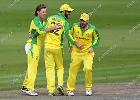 Australia's Adam Zampa, left, Glenn Maxwell, center, and captain Aaron Finch celebrate the dismissal of England's Jos Buttler during the third ODI cricket match between England and Australia, at Old Trafford in Manchester, England