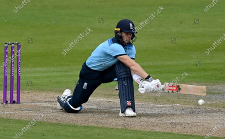 England's Sam Billings plays reverse sweep during the third ODI cricket match between England and Australia, at Old Trafford in Manchester, England