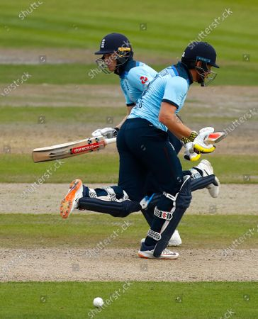 England's Jonny Bairstow, right, and Sam Billings run between the wickets to score during the third ODI cricket match between England and Australia, at Old Trafford in Manchester, England