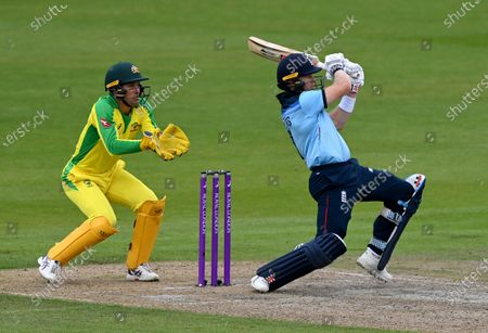 Australia's wicketkeeper Alex Carey, left, reacts as England's Sam Billings plays a shot during the third ODI cricket match between England and Australia, at Old Trafford in Manchester, England