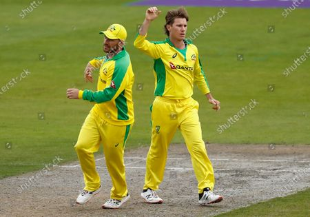 Australia's Adam Zampa, right, celebrates with captain Aaron Finch the dismissal of England's Sam Billings during the third ODI cricket match between England and Australia, at Old Trafford in Manchester, England