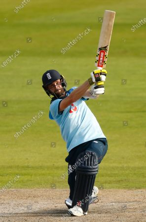 England's Chris Woakes plays a shot during the third ODI cricket match between England and Australia, at Old Trafford in Manchester, England