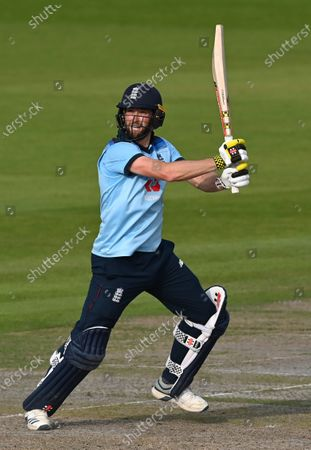 England's Chris Woakes bats during the third ODI cricket match between England and Australia, at Old Trafford in Manchester, England