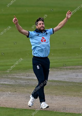 Stock Photo of England's Chris Woakes celebrates the dismissal of Australia's captain Aaron Finch during the third ODI cricket match between England and Australia, at Old Trafford in Manchester, England