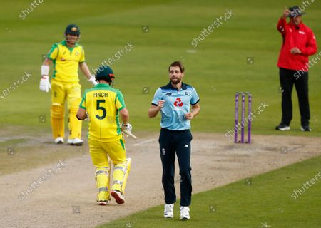 Stock Image of England's Chris Woakes, second right, celebrates the dismissal of Australia's captain Aaron Finch, second left, during the third ODI cricket match between England and Australia, at Old Trafford in Manchester, England