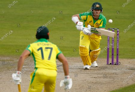Australia's David Warner, right, plays a shot during the third ODI cricket match between England and Australia, at Old Trafford in Manchester, England