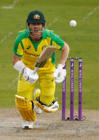 Australia's David Warner reacts after playing a shot during the third ODI cricket match between England and Australia, at Old Trafford in Manchester, England