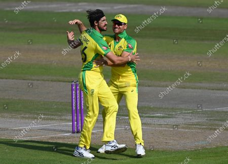 Australia's Mitchell Starc, left, celebrates with teammate Marcus Stoinis the dismissal of England's Jason Roy during the third ODI cricket match between England and Australia, at Old Trafford in Manchester, England