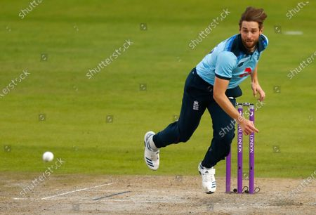 Stock Picture of England's Chris Woakes bowls a delivery during the third ODI cricket match between England and Australia, at Old Trafford in Manchester, England