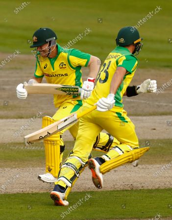 Australia's David Warner, left, and Marnus Labuschagne run between the wickets to score during the third ODI cricket match between England and Australia, at Old Trafford in Manchester, England