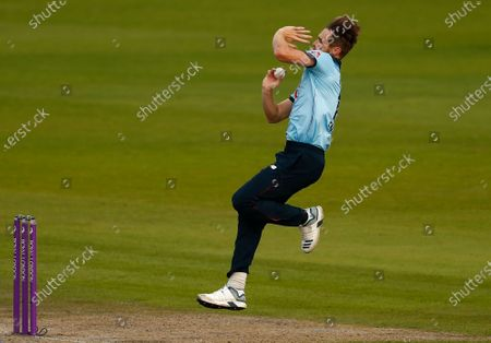 England's Chris Woakes bowls during the third ODI cricket match between England and Australia, at Old Trafford in Manchester, England