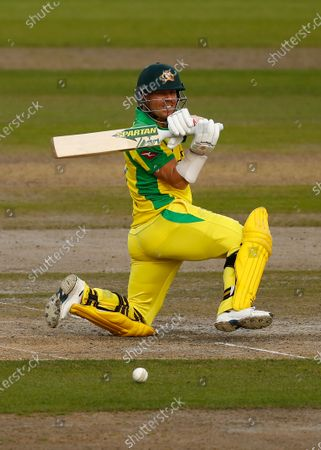 Australia's David Warner plays a shot during the third ODI cricket match between England and Australia, at Old Trafford in Manchester, England