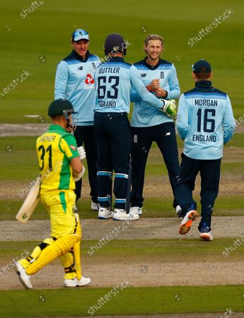 Stock Photo of England's Joe Root, second right, celebrates with teammates the dismissal of Australia's David Warner, left, during the third ODI cricket match between England and Australia, at Old Trafford in Manchester, England