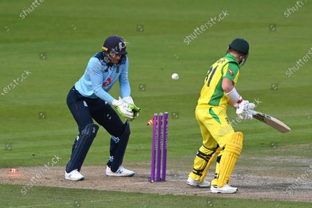 Stock Picture of Australia's David Warner, right, is bowled out by England's Joe Root during the third ODI cricket match between England and Australia, at Old Trafford in Manchester, England