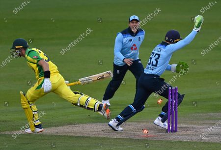 Stock Image of England's wicketkeeper Jos Buttler, right, celebrates the run-out of Australia's Marnus Labuschagne, left, during the third ODI cricket match between England and Australia, at Old Trafford in Manchester, England