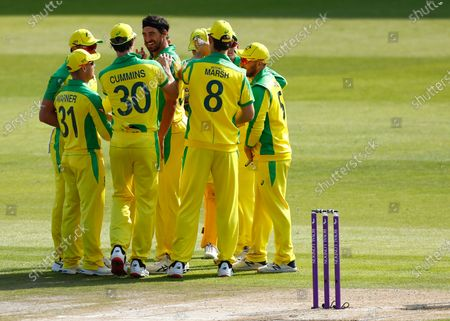 Australia's Mitchell Starc, center, celebrates with teammates the dismissal of England's Jason Roy during the third ODI cricket match between England and Australia, at Old Trafford in Manchester, England